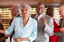 Mature dancing couple at an active adult community