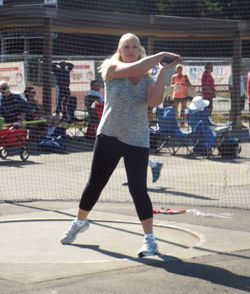 Woman competing in the discus throw at the Washington State Senior Games